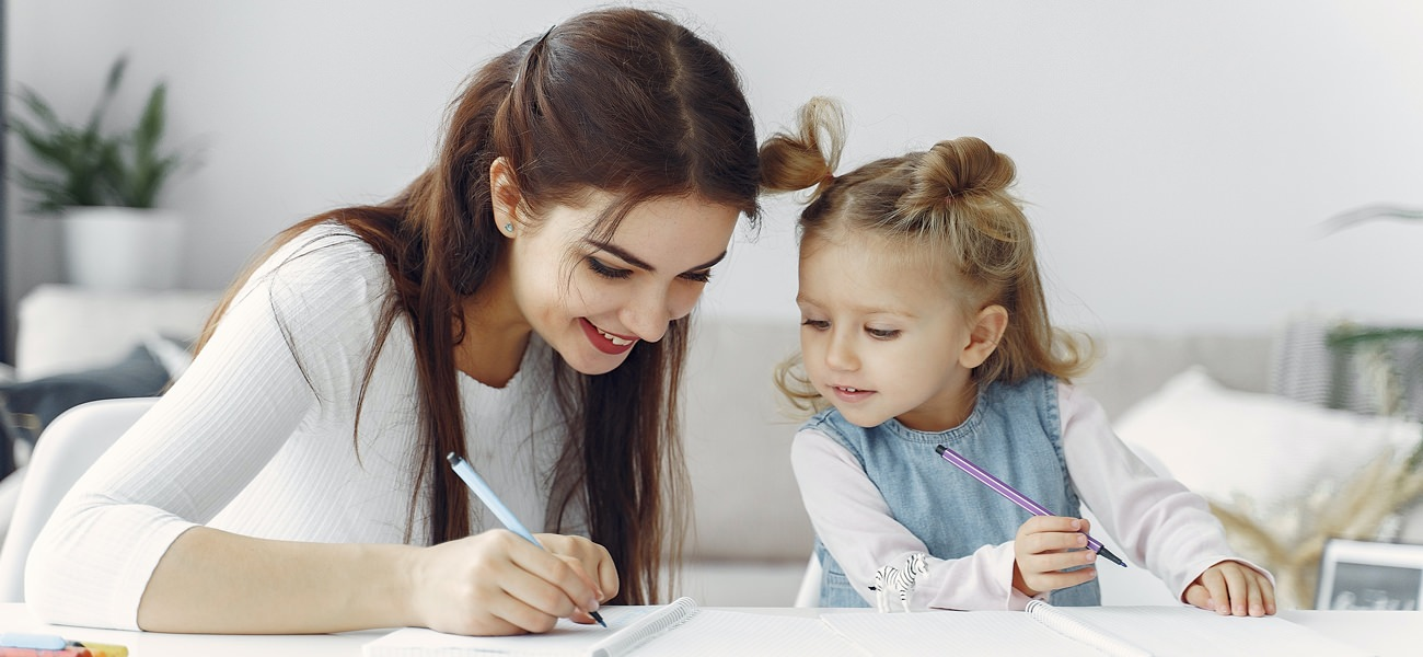 Lifestyle image of mother and daughter drawing